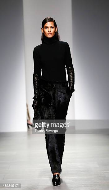 A model walks the runway at the DAKS show at London Fashion Week AW14 at Somerset House on February 14 2014 in London England