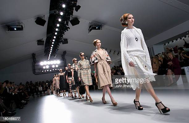 * A model walks the runway at the DAKS show during London Fashion Week SS14 at BFC Courtyard Showspace on September 13 2013 in London England