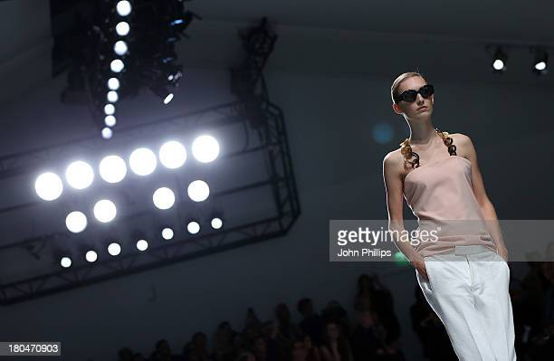 A model walks the runway at the DAKS show during London Fashion Week SS14 at BFC Courtyard Showspace on September 13 2013 in London England