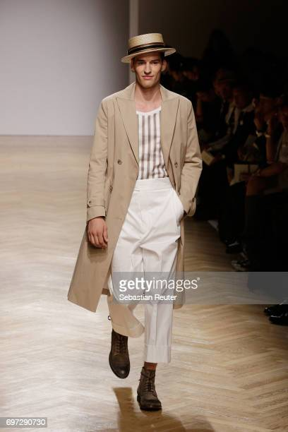 A model walks the runway at the Daks show during Milan Men's Fashion Week Spring/Summer 2018 on June 18 2017 in Milan Italy