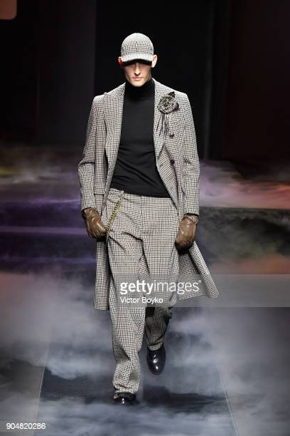A model walks the runway at the Daks show during Milan Men's Fashion Week Fall/Winter 2018/19 on January 14 2018 in Milan Italy