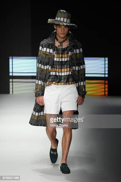 A model walks the runway at the Daks show during Milan Men's Fashion Week Spring/Summer 2019 on June 17 2018 in Milan Italy