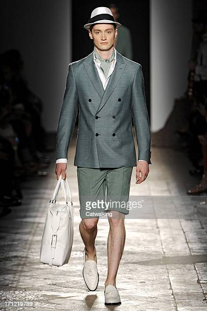 A model walks the runway at the Daks Spring Summer 2014 fashion show during Milan Menswear Fashion Week on June 23 2013 in Milan Italy