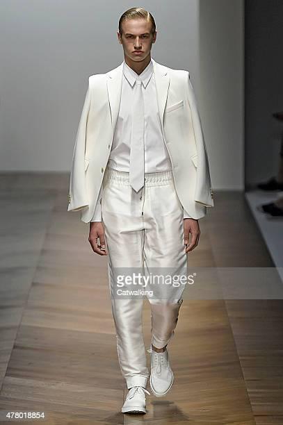 A model walks the runway at the Daks Spring Summer 2016 fashion show during Milan Menswear Fashion Week on June 21 2015 in Milan Italy