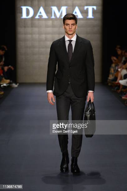 A model walks the runway at the Damat show during MercedesBenz Istanbul Fashion Week at the Zorlu Performance Hall on March 19 2019 in Istanbul Turkey