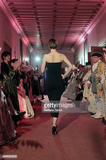 A model walks the runway at the Damiani fashion show during the Gala Dinner of Venice Carnival 2014 at Palazzo Nani Bernardo and organized by Palazzo...