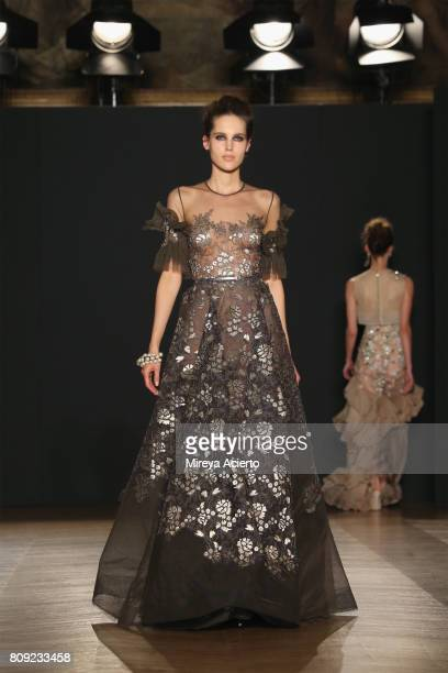 Model walks the runway at the Dany Atrache Haute Couture Fall/Winter 2017-2018 show as part of Haute Couture Paris Fashion Week on July 4, 2017 in...