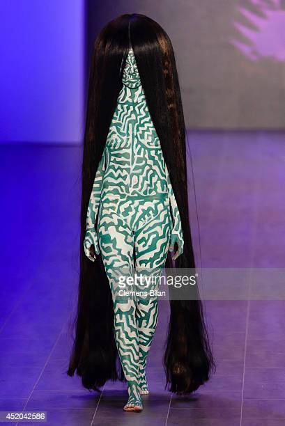 A model walks the runway at the Dare By Johny Dar show during the MercedesBenz Fashion Week Spring/Summer 2015 at Erika Hess Eisstadion on July 11...