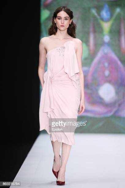 A model walks the runway at the Dasha Gauzer fashion show during day three of Mercedes Benz Fashion Week Russia S/S 2018 at Manege on October 23 2017...
