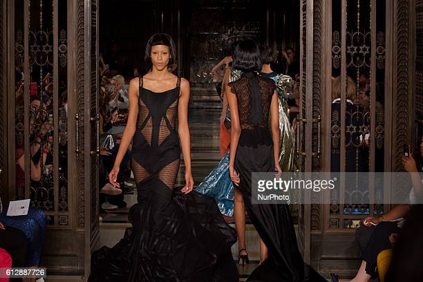 A model walks the runway at the David Ferreira show during London Fashion Week Spring/Summer collections 2017 on September 20 2016 in London United...