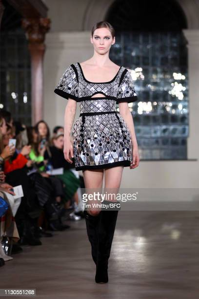 A model walks the runway at the David Koma show during London Fashion Week February 2019 at the St George's Church Bloomsbury on FEBRUARY 18 2019 in...