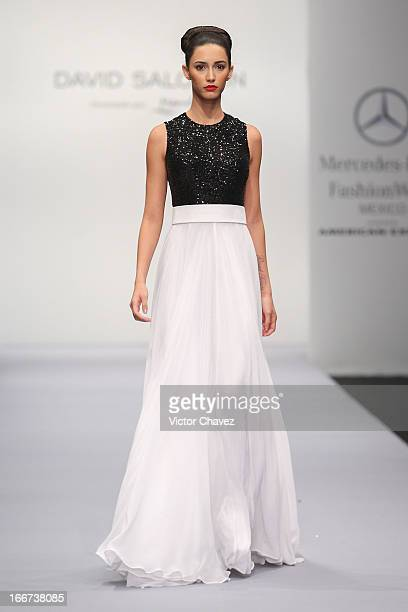 A model walks the runway at the David Salomon Fall/Winter 2013 collection during the first day of MerecedsBenz Fashion Week Mexico at Carpa Santa Fe...