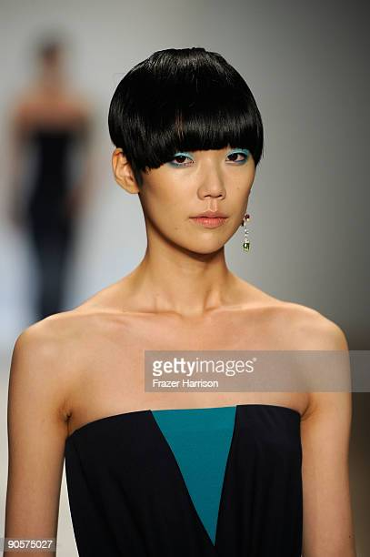 A model walks the runway at the Davidelfin Spring 2010 Fashion Show at the Promenade during MercedesBenz Fashion Week at Bryant Park on September 10...