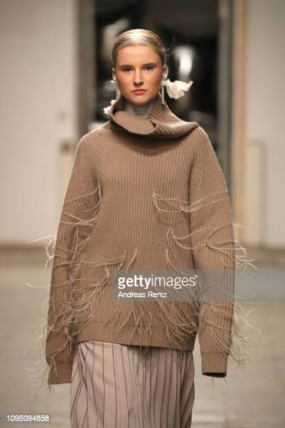 A model walks the runway at the Dawid Tomaszewski Defile during the Berlin Fashion Week Autumn/Winter 2019 on January 16 2019 in Berlin Germany