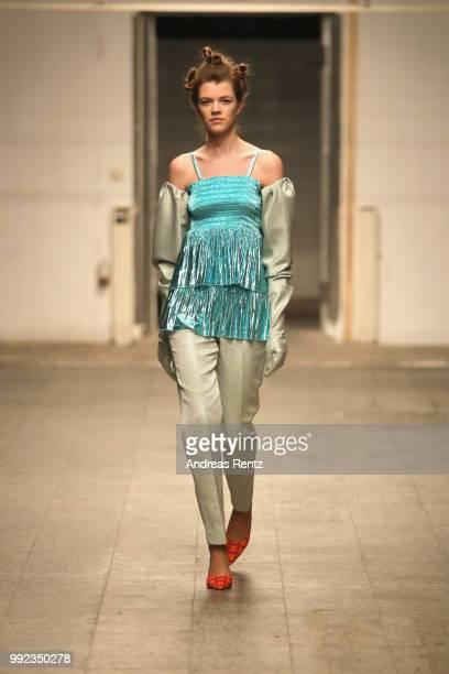 A model walks the runway at the Dawid Tomaszewski Defilee during 'Der Berliner Salon' Spring/Summer 2019 on July 5 2018 in Berlin Germany