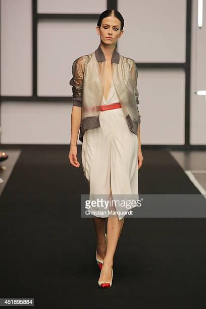 A model walks the runway at the Dawid Tomwaszewski show during the MercedesBenz Fashion Week Spring/Summer 2015 at Tischlerei der Deutschen Oper...