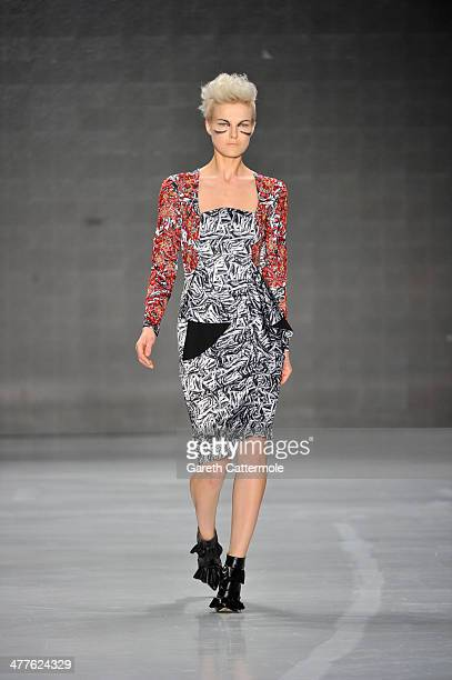 A model walks the runway at the DB Berdan by L'Oreal Professional show during MBFWI presented by American Express Fall/Winter 2014 on March 10 2014...
