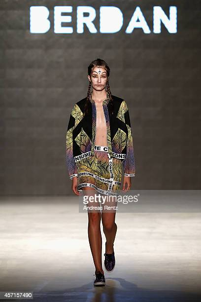 A model walks the runway at the DB Berdan show during Mercedes Benz Fashion Week Istanbul SS15 at Antrepo 3 on October 13 2014 in Istanbul Turkey
