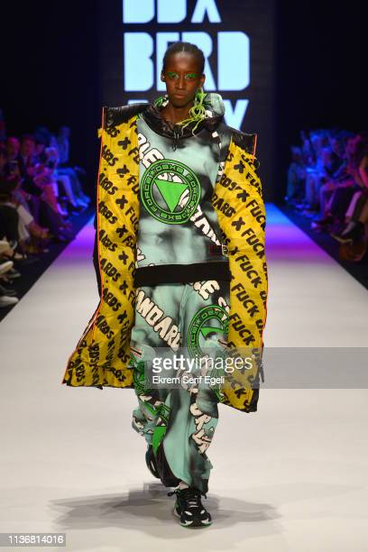 A model walks the runway at the DB Berdan show during MercedesBenz Istanbul Fashion Week at the Zorlu Performance Hall on March 19 2019 in Istanbul...