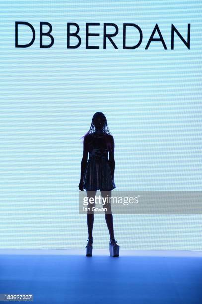 A model walks the runway at the DB Berdan show during MercedesBenz Fashion Week Istanbul s/s 2014 presented by American Express on October 8 2013 in...