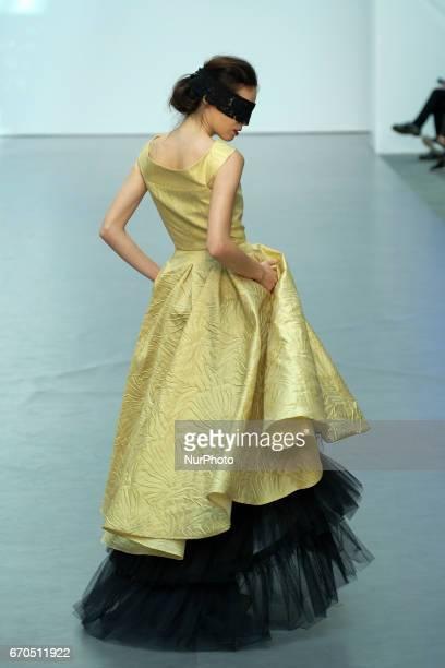 A model walks the runway at the De la Cierva y Nicolas show during the Madrid Bridal Week 2017 at Palacio de Cibeles on April 19 2017 in Madrid Spain