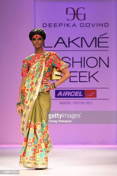 Model walks the runway at the Deepika Govind show at The Lakme Fashion Week Winter/Festive 2012 day 3 at the Grand Hyatt on August 5, 2012 in Mumbai,...
