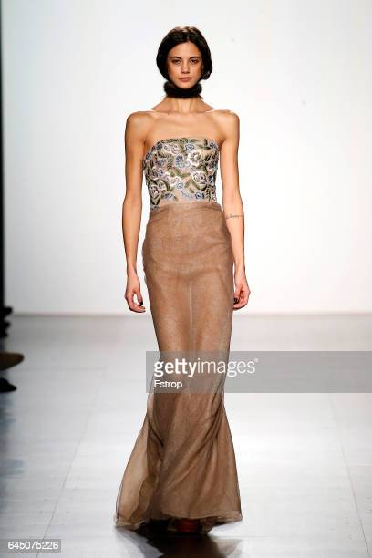 A model walks the runway at the Denis Basso show during the New York Fashion Week February 2017 collections on February 14 2017 in New York City