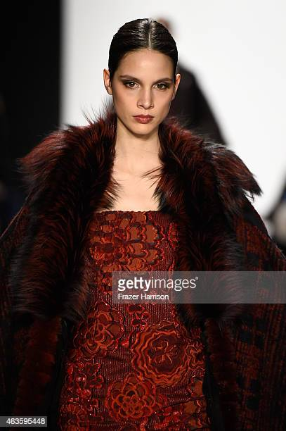 A model walks the runway at the Dennis Basso fashion show during MercedesBenz Fashion Week Fall 2015 at The Theatre at Lincoln Center on February 16...