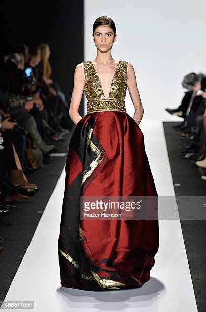 A model walks the runway at the Dennis Basso fashion show during MercedesBenz Fashion Week Fall 2014 at The Theatre at Lincoln Center on February 10...