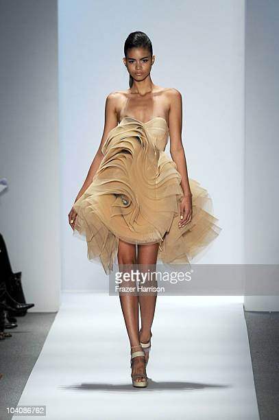 A model walks the runway at the Dennis Basso Spring 2011 fashion show during MercedesBenz Fashion Week at The Stage at Lincoln Center on September 14...