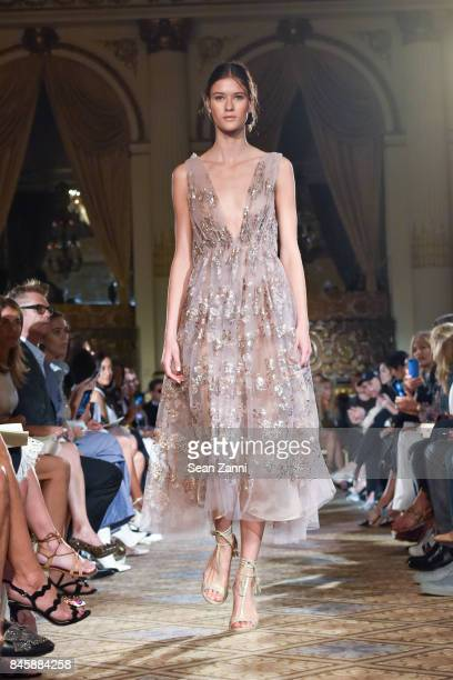A model walks the runway at the Dennis Basso Spring/Summer 2018 Runway Show during New York Fashion Week at The Plaza Hotel on September 11 2017 in...