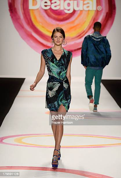 Model walks the runway at the Desigual Spring 2014 fashion show at The Theatre at Lincoln Center on September 5, 2013 in New York City.