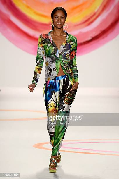 A model walks the runway at the Desigual Spring 2014 fashion show at The Theatre at Lincoln Center on September 5 2013 in New York City