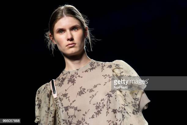 A model walks the runway at the 'Devota y Lomba' catwalk during the MercedesBenz Madrid Fashion Week Spring/Summer in Madrid Spain July 09 2018