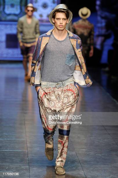 A model walks the runway at the DG menswear fashion show during Milan Fashion Menswear Week on June 20 2011 in Milan Italy