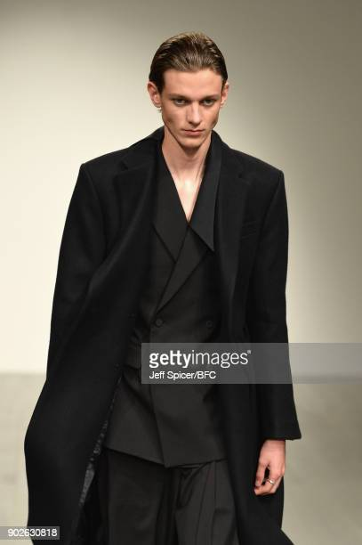 A model walks the runway at the DGNAK show during London Fashion Week Men's January 2018 at BFC Show Space on January 8 2018 in London England