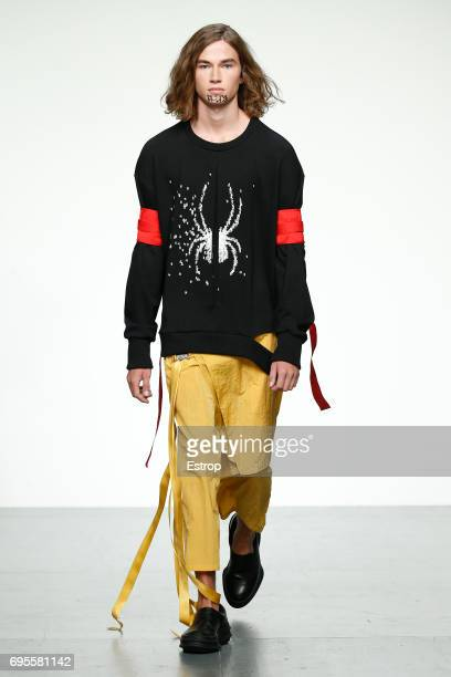 Model walks the runway at the D.Gnak show during the London Fashion Week Men's June 2017 collections on June 12, 2017 in London, England.