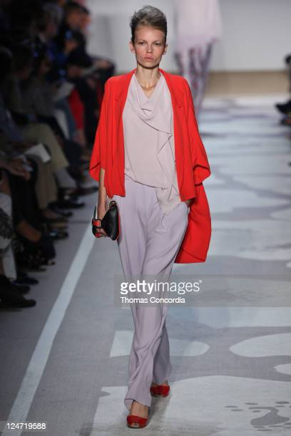 Model walks the runway at the Diane Von Furstenberg Spring 2012 fashion show during Mercedes-Benz Fashion Week at The Theater at Lincoln Center on...