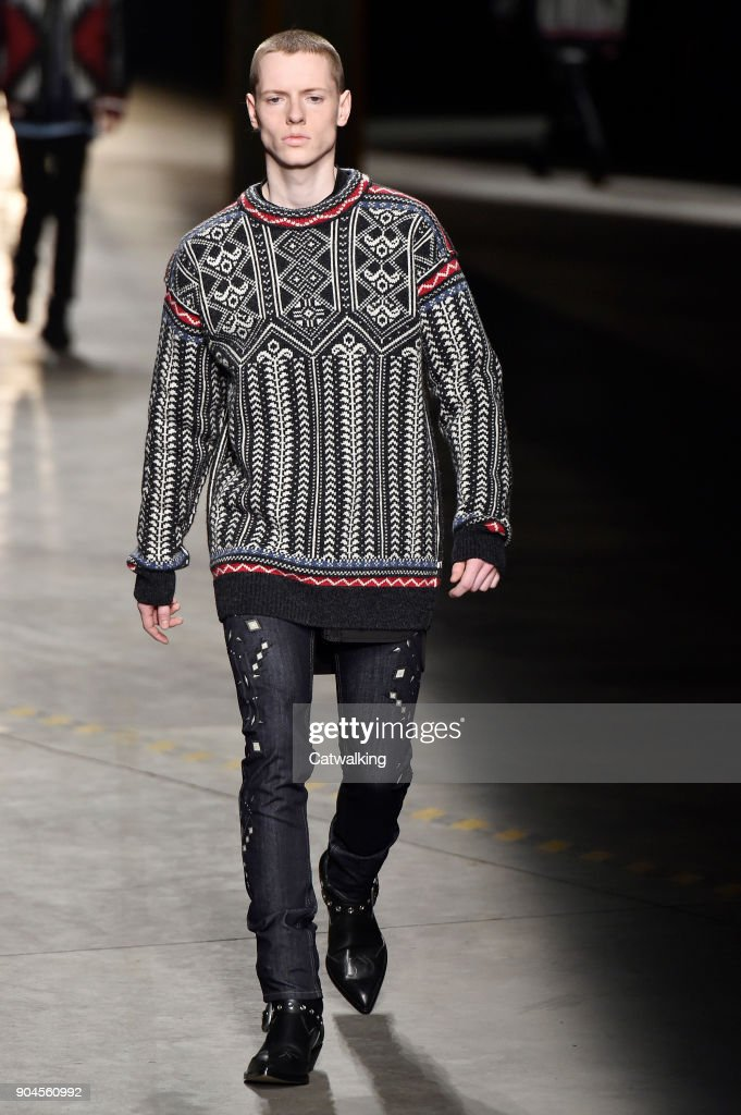 A model walks the runway at the Diesel Black Gold Autumn Winter 2018 fashion show during Milan Menswear Fashion Week on January 13, 2018 in Milan, Italy.