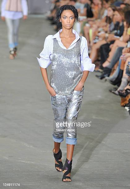 A model walks the runway at the Diesel Black Gold during MercedesBenz Fashion Week Spring 2012 at Lincoln Center on September 13 2011 in New York City
