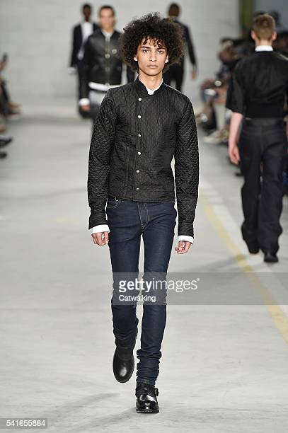 A model walks the runway at the Diesel Black Gold Spring Summer 2017 fashion show during Milan Menswear Fashion Week on June 20 2016 in Milan Italy