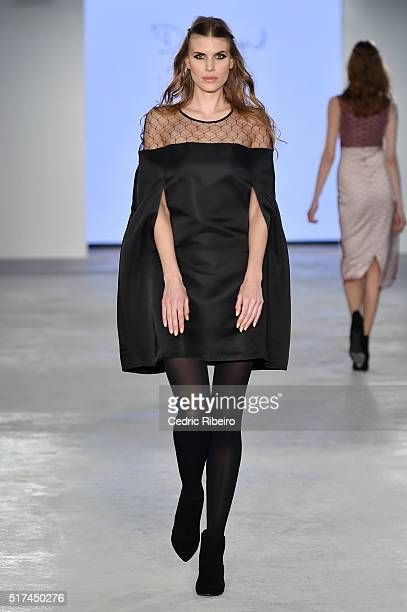 A model walks the runway at the Dima Ayad show during Dubai Collections March 2016 by Emaar at Burj Khalifa on March 25 2016 in Dubai United Arab...
