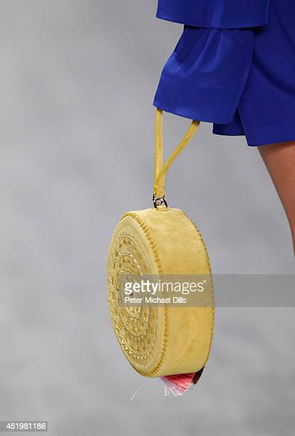 A model walks the runway at the Dimitri show during the MercedesBenz Fashion Week Spring/Summer 2015 at Erika Hess Eisstadion on July 10 2014 in...