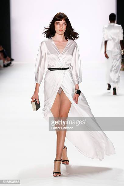 A model walks the runway at the Dimitri show during the MercedesBenz Fashion Week Berlin Spring/Summer 2017 at Erika Hess Eisstadion on June 30 2016...