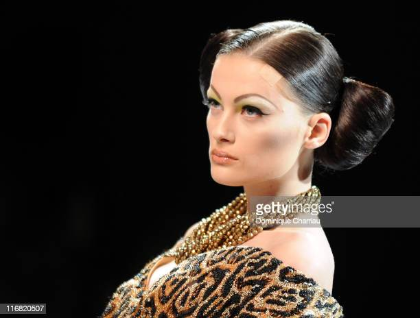 A model walks the runway at the Dior '09 Fall Winter Haute Couture fashion show at the Rodin Museum on June 30 2008 in Paris France