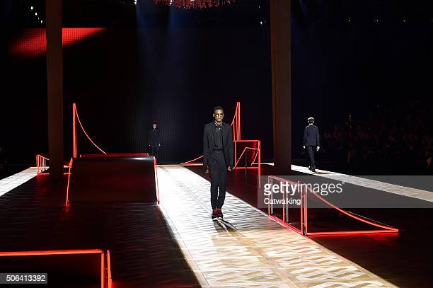 A model walks the runway at the Dior Homme Autumn Winter 2016 fashion show during Paris Menswear Fashion Week on January 23 2016 in Paris France