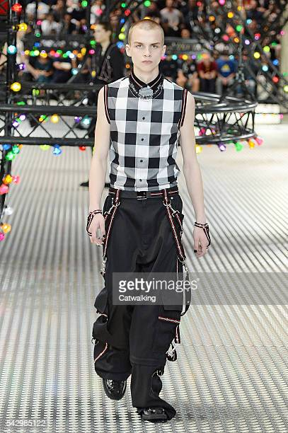 A model walks the runway at the Dior Homme Spring Summer 2017 fashion show during Paris Menswear Fashion Week on June 25 2016 in Paris France