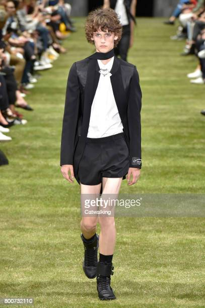 A model walks the runway at the Dior Homme Spring Summer 2018 fashion show during Paris Menswear Fashion Week on June 24 2017 in Paris France