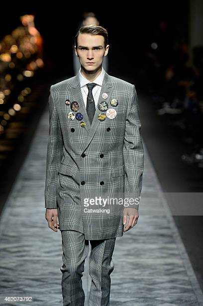 A model walks the runway at the Dior Homme Studio Autumn Winter 2015 fashion show during Paris Menswear Fashion Week on January 24 2015 in Paris...