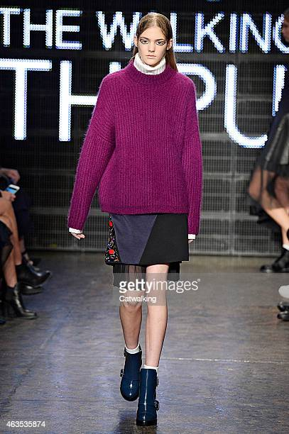 A model walks the runway at the DKNY Autumn Winter 2015 fashion show during New York Fashion Week on February 15 2015 in New York United States